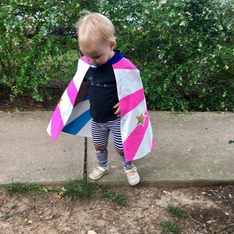 toddler in cape